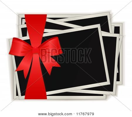 The photos which have been tied up by a red ribbon