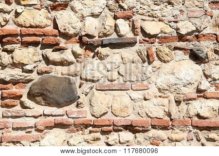 Wall Of Stones And Red Bricks With Lime And Cement