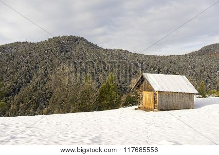 Mountain Cabin In Fresh Winter Snow