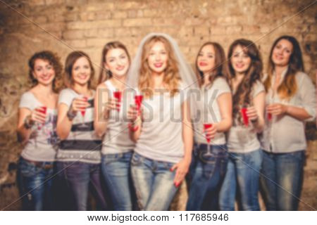 Blurred Photo Of Girls Celebrating A Bachelorette Party Of Bride.