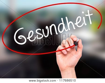 Man Hand Writing Gesundheit (health In German)  With Black Marker On Visual Screen.