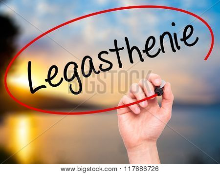 Man Hand Writing Legasthenie (dyslexia In German) With Black Marker On Visual Screen.