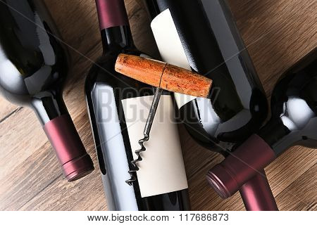 Top view of wine bottles and corkscrew.