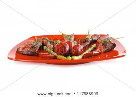 meat slices and asparagus on red over white