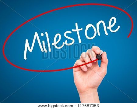 Man Hand Writing Milestone With Black Marker On Visual Screen.