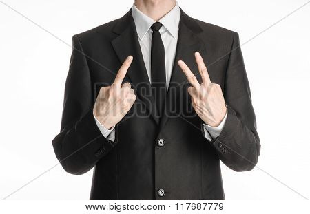 Businessman And Gesture Topic: A Man In A Black Suit With A Tie Showing A Sign With His Right Hand A