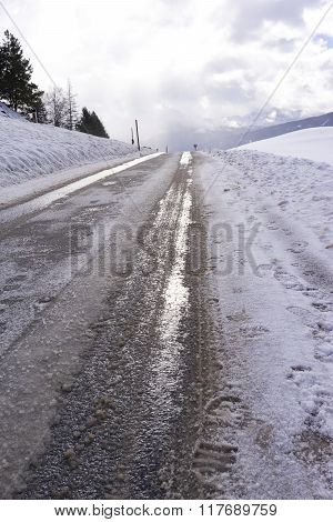 Low Angle View Of Dirty Snow With Tyre Tracks
