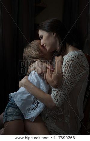 Happy Mother Hugging Her Little Daughter