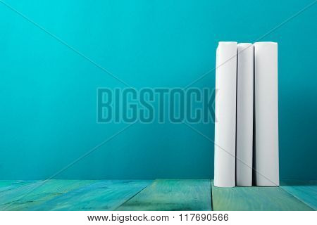 Row of colorful books, grungy blue background, free copy space V
