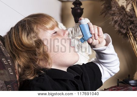 A Teenager Asthma on the living room sofa