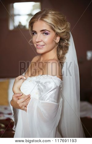 Beauty Fashion Bride Wedding Portrait. Beautiful Smiling Girl Posing On Camera At Home In Modern Int