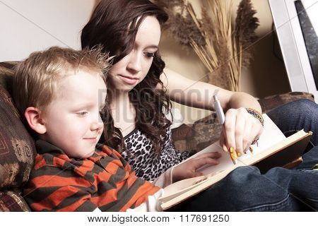 A Babysitter Writing something on a book