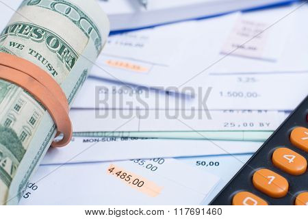 Invoices And Bills, Roll Of Dollar Banknotes, Calculator, Different Amounts