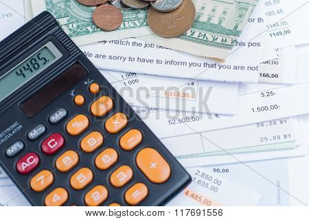 Mortgage And Utility Bills, Coins And Banknotes, Calculator