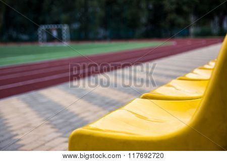 Old yellow seats in the stadium. Sport background