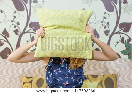 Girl Hiding Behind A Pillow