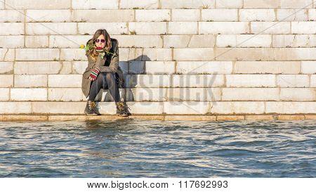 Girl Sitting At The River Bank