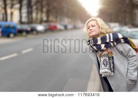 Attractive Blond Woman Waiting For A Cab Or A Lift