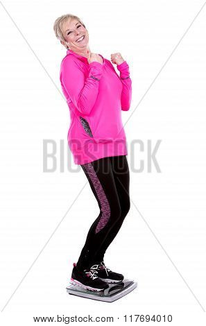 Fit Woman Stepping On Scale