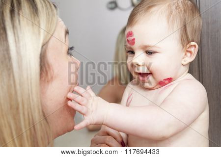 Mother kissing her baby, close up portraits
