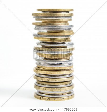 Columns of golden and silver coins isolated on white background. Money concept, investment bank