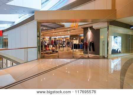 HONG KONG - JANUARY 26, 2016: entrance to H&M store. H&M is a Swedish multinational retail-clothing company, known for its fast-fashion clothing for men, women, teenagers and children.