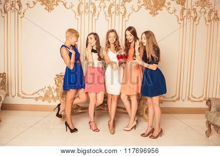 Portrait Of Nice Surprised Girls Looking At Bride's Wedding Ring