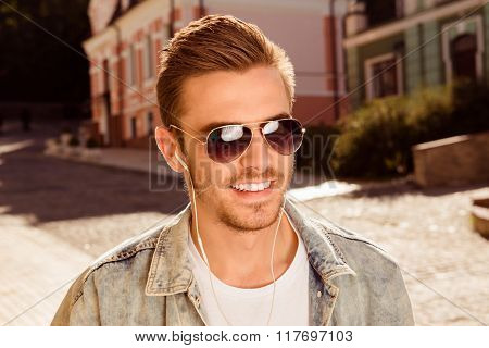Close Up Photo Of Smiling Man In Spectacles And Headphones