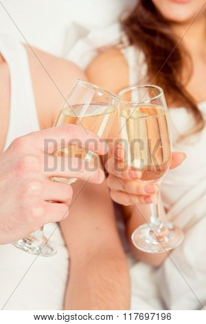 Close Up Photo Of Couple In Love Clinking Glasses Of Champagne
