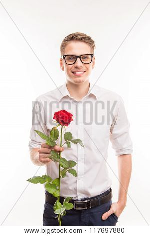 Handsome  Man In Glasses With A Red Rose Holding Hand In Pocket