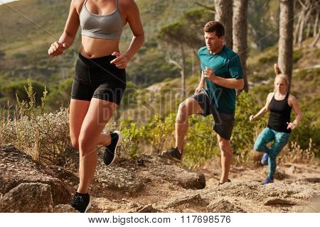 Fit Young People Running Up A Hill
