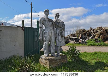 Russia, Elitnyy - Jul 15, 2015: Monument to Worker and Collective Farm. Old monument in Russian farm.