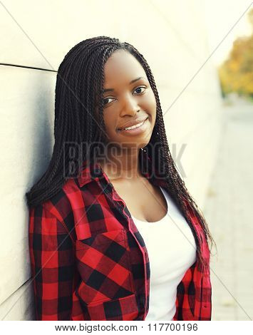 Portrait Of Beautiful Young African Woman With Dreadlocks Hair In City