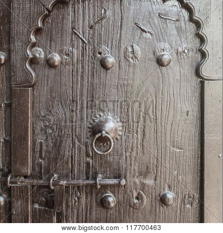 Closeup of antique islamic wooden door.