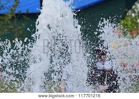 Jets street fountain. Spray on the fly.
