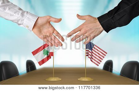 Lebanon and United States diplomats shaking hands to agree deal