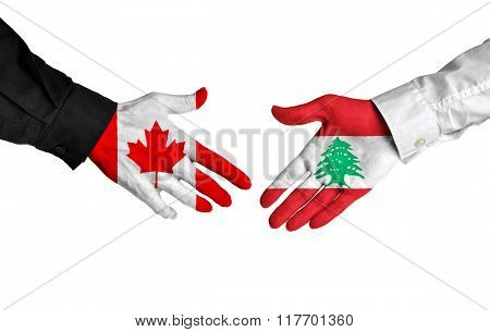 Canada and Lebanon leaders shaking hands on a deal agreement
