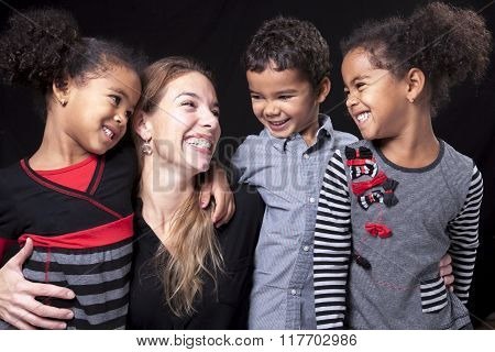 A family over dark background