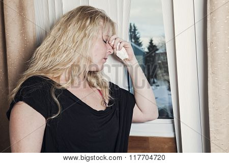 Woman depress window