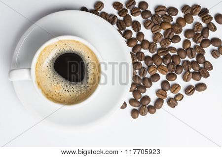 Cup Of Coffee With Foam And Roasted Beans