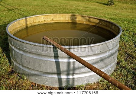 Water to a stock tank from water well pipe