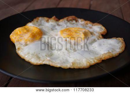Fried Egg On Black Dish