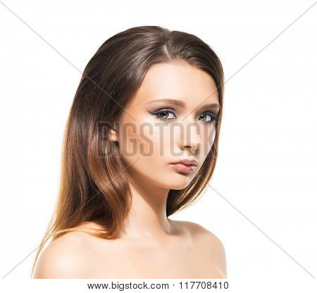 Attractive young woman with smooth skin on isolated background.
