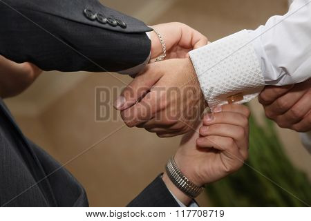 Witness Helps To Wear Cufflinks To The Groom