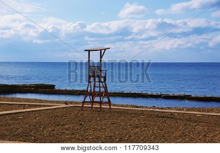 Rescue Post On Beach On Background Of Sea With Blue Sky