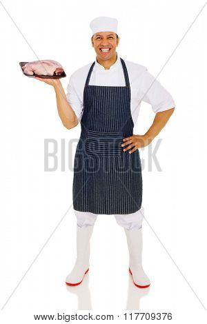 cheerful middle aged chef holding red meat isolated on white