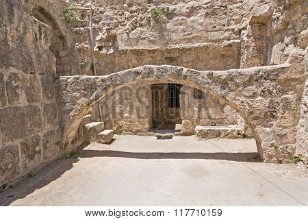 Arch before building entrance in Pool of Bethesda ruins in Old City of Jerusalem