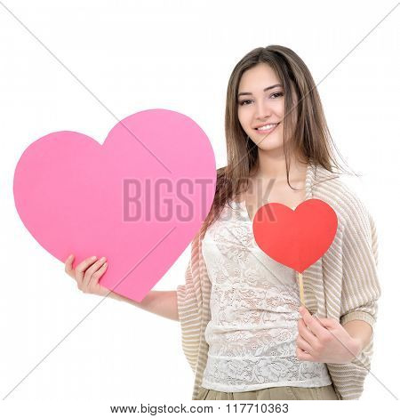 Portrait of attractive happy smiling teen girl with pink and red hearts, love holiday valentine symbol over white background