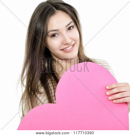 Portrait of attractive happy smiling teen girl with pink heart, love holiday valentine symbol over white background