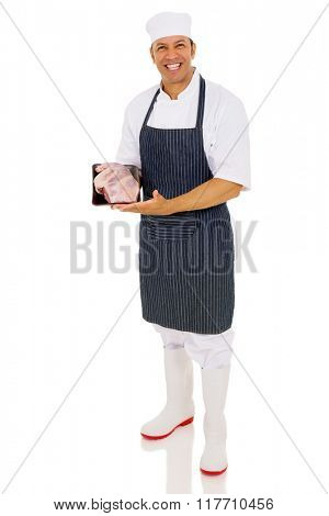 portrait of happy butcher showing fresh meat isolated on white background